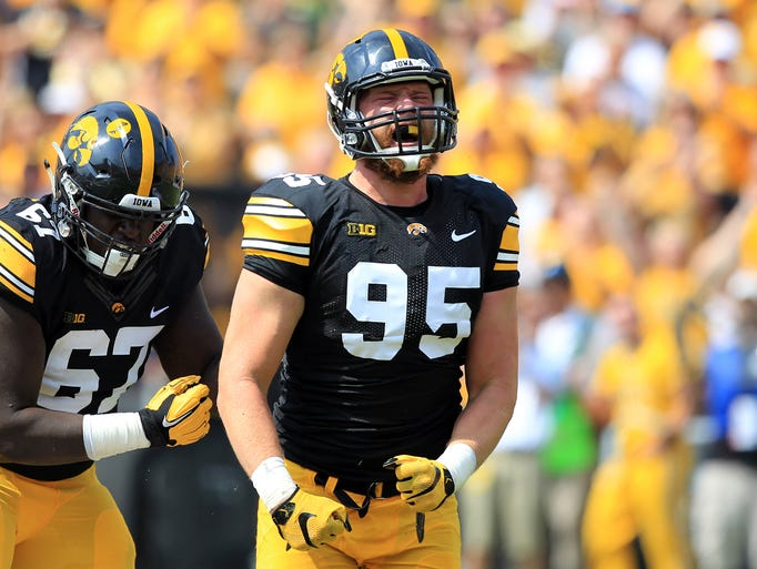 Iowa's Drew Ott celebrates his sack on Illinois State
