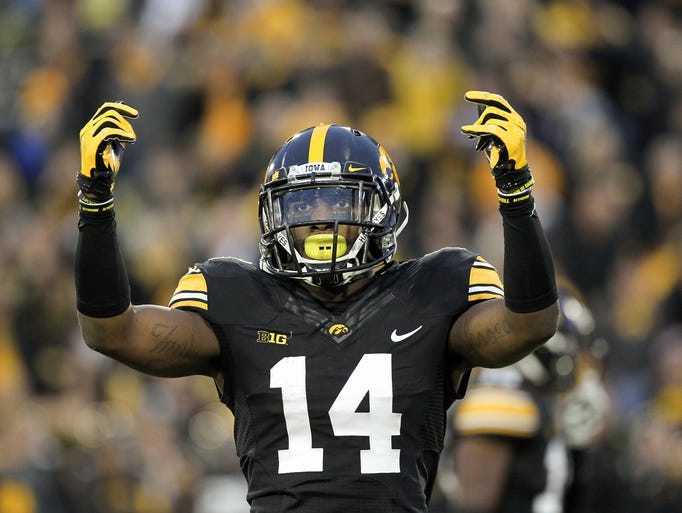 Iowa's Desmond King hypes up the crowd during the Hawkeyes'