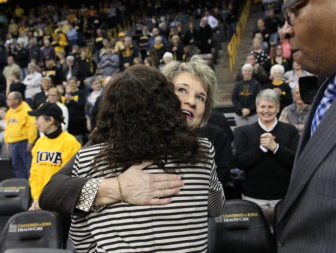 Iowa head coach Lisa Bluder gets a hug from Rutgers