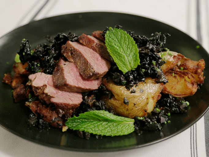 The milk-braised lamb with black trumpet mushrooms,