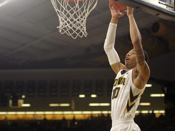 Iowa's Christian Williams goes up for a dunk during