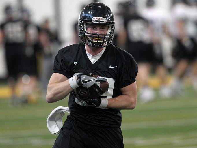 Iowa wide receiver Matt Vandeberg pulls in a pass at