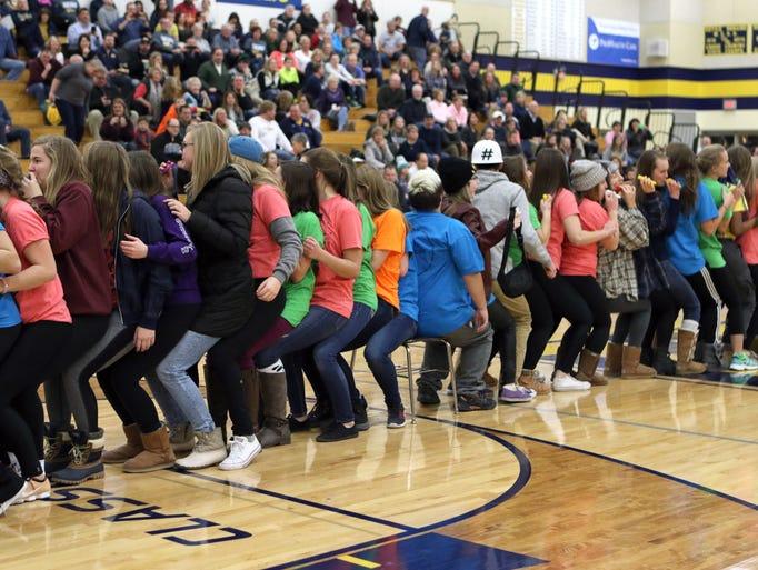 Kettle Moraine High School students sit lap to lap,