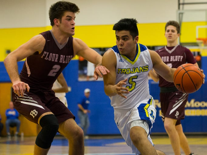 Moody's Jordan Perez drives the ball up the court as