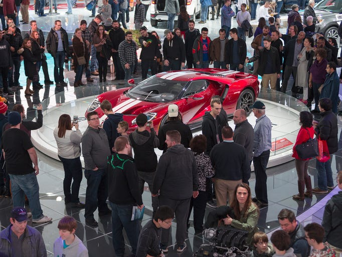 Attendees gather around a 2017 Ford GT during the 2017