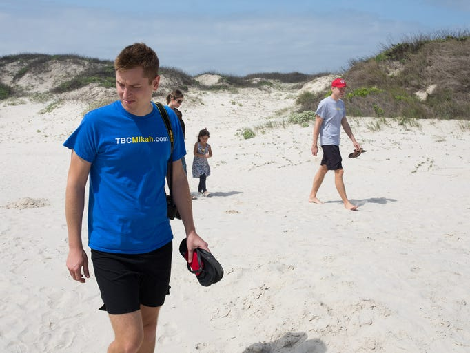 Mikah Meyer walks along the beach at Padre Island National