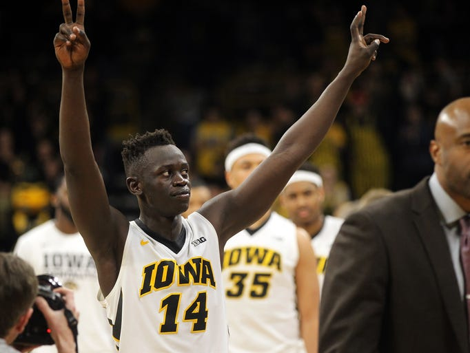 Peter Jok waves to fans following the Hawkeyes' NIT