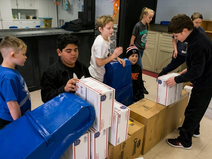 Kids on The Boxers' team build a fort out of boxes