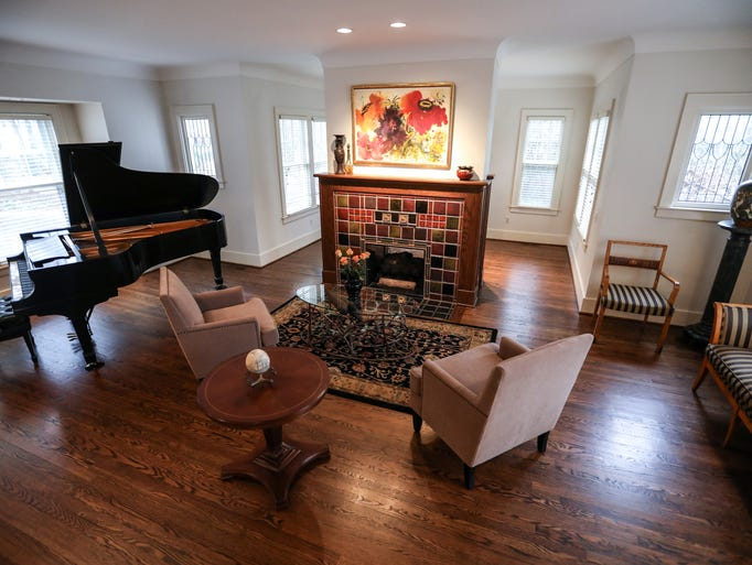 The formal living room features double fireplace in
