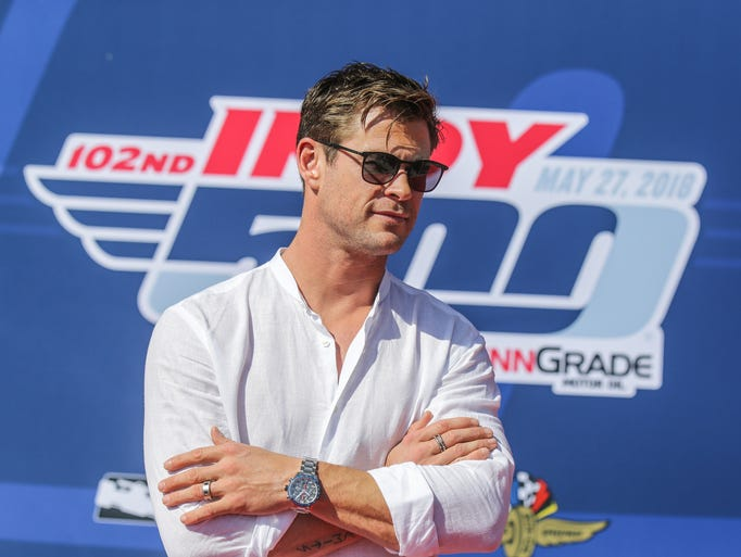 Actor Chris Hemsworth walks the red carpet during the