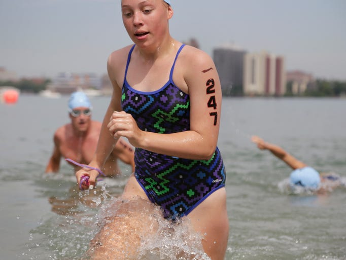 Photos swimmers make a splash in the detroit river at for Charity motors 8 mile lahser