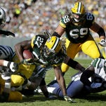 Green Bay Packers' Eddie Lacy runs the ball up the middle in the second quarter.