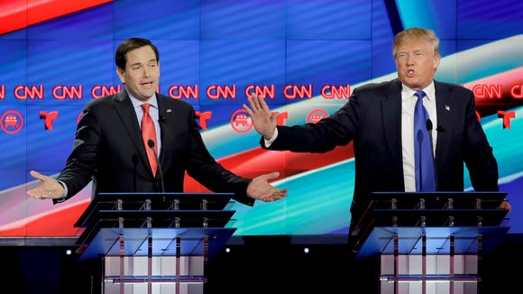 Marco Rubio and Donald Trump speak during the Republican presidential primary debate at the University of Houston on Feb. 25, 2016.