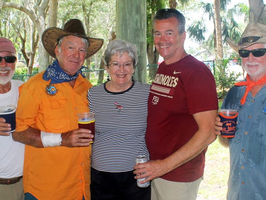 Barb Markel is surrounded by cowboys Rob Reiley, Dave