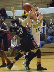 Plainview's Alex Harrison (10) goes up for a layup
