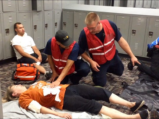 EMTs tend to a victim during an active-shooter training exercise in 2016 in West Des Moines.