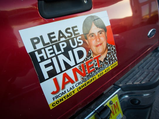 A sign on a vehicle parked outside the home of the