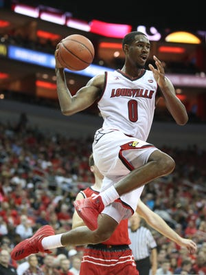 Louisville's V.J. King flew through the air on the way to the basket. Oct. 13, 2017