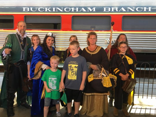 Mia Pugh as Helga Hufflepuff along with Chris Pugh as Godric Gryffindor, and Dianna and Dan Pittman as Rowena Ravenclaw and Salazar Slytherin welcome Hogwarts Express at Staunton train station during the Queen City Mischief & Magic festival on Saturday, Sept. 23, 2017.