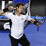 Andy Murray of Britain celebrates after defeating David Ferrer of Spain in their Wednesday quarterfinal match at the Australian Open in Melbourne.