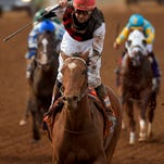 Jockey Kent Desormeaux celebrates after riding Texas Red to victory in the Breeders' Cup Juvenile horse race at Santa Anita Park, Saturday, Nov. 1, 2014, in Arcadia, Calif. (AP Photo/Mark J. Terrill)