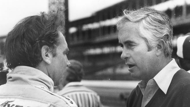FILE – Bill Alsup (left) listens to team owner Roger Penske after learning his qualifying run on the fourth day of time trials, which had bumped him into the field, has been disqualified. Alsup did not make the starting field.