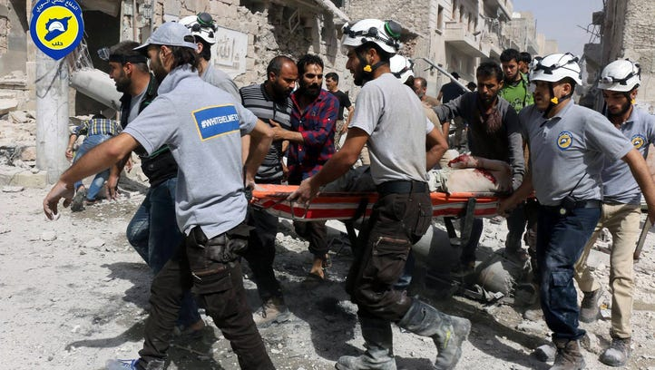 Amid bombs, Syrian mother vows, 'We will not leave our homes'