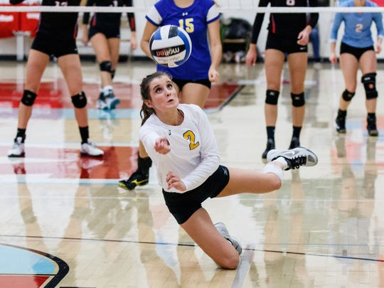 Mukwonago's Katie Schoessow (2) makes a diving save during the sectional semifinal match at Arrowhead on Thursday, Oct. 27, 2016. Schoessow, a Marquette University recruit, is one of the state's best liberos.