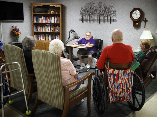 Randy McQueen reads to patients at Mercy Hospital in Oelwein where he volunteers. on Thursday, Sept. 1, 2016. McQueen, who was born with a condition that causes dwarfism, is receiving  a national volunteer of year award from the American Healthcare Association.