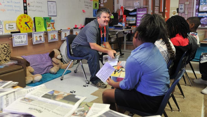 Wichita Falls Times Record News sports editor Andy Newberry spoke with Washington Elementary School students Friday during the school career day. Newberry spoke to the students about his education and his choices that moved him to his career at the Times Record News.
