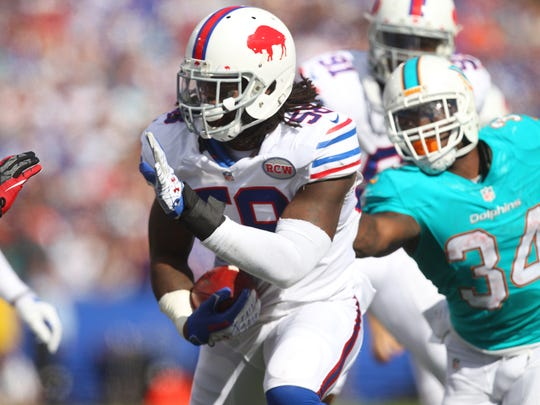 Bills Randell Johnson (58) recovers  a Jarvis Landy fumble on a punt.