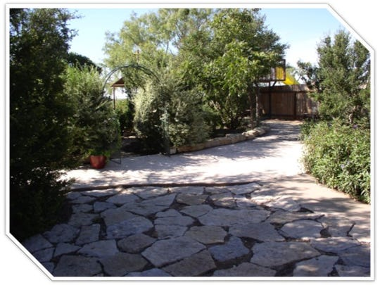 The Flanagan xeriscape yard features natural resources from the ranch.