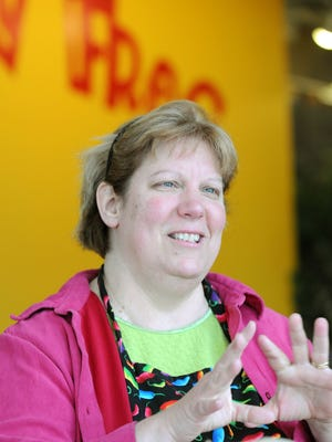 Sue Harju is shown shortly after she purchased The Urban Frog in 2010.