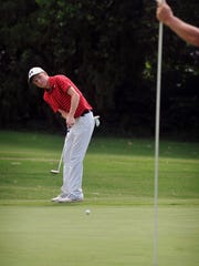 Karsten Kimbrough of Holliday hits a long putt from the fringe on Number 11 during the opening round of the Texas-Oklahoma Junior Golf Championship Monday at the Wichita Falls Country Club.