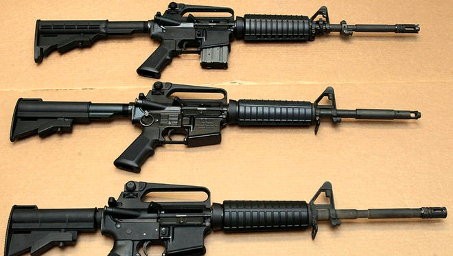 In this Aug. 15, 2012 file photo, three variations of the AR-15 assault rifle are displayed.
