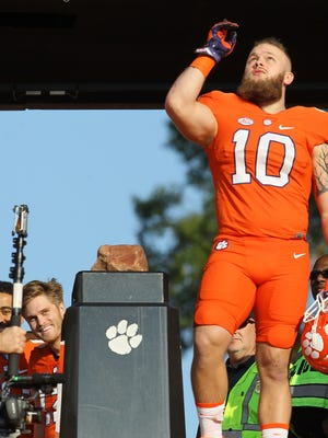 Clemson linebacker Ben Boulware points to the sky before running down the Hill during Senior Day festivities on Saturday at Memorial Stadium.