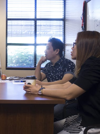 Linda Chan (right) and Ken Chan (center, Mighty PC) talk with Chad Haas (left, TriageNow), Oct. 10, 2017, in Haas' office at 55 S. McQueen Road, Gilbert, Ariz.