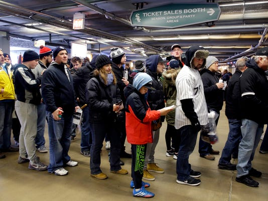 Fans leave the ballpark after a baseball game between the Chicago White Sox and the Cleveland Indians was canceled due to rain at U. S. Cellular Field, Sunday, April 10, 2016, in Chicago. (AP Photo/Nam Y. Huh)