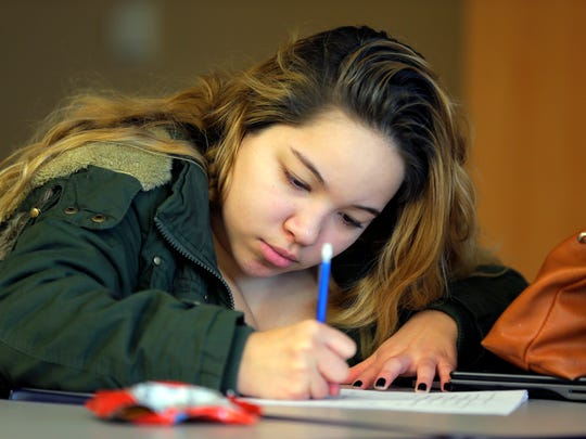 Angie Tafur, 18, of Somerville, works independently