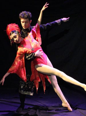 """Featured performer Lesley Lopez, left, and University of Texas at El Paso dance student Julian Maldonado perform in """"The Firebird,"""" part of the UTEP Department of Theatre and Dance's faculty-choreographed concert."""