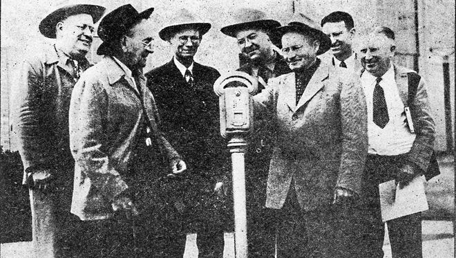 It was a great day, at least for the seven gentlemen who posed for a front-page photograph with Mesa's first parking meter.