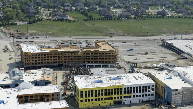 Photographed earlier this month, construction continues on the $350 million Liberty Center mixed-use development near the intersection of Interstate 75 and Liberty Way in Liberty Township.