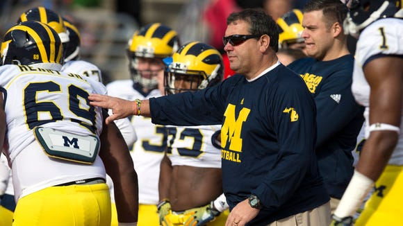 Nov 29, 2014; Columbus, OH, USA; Michigan Wolverines head coach Brady Hoke watches his team warm up before the game against the Ohio State Buckeyes at Ohio Stadium. Mandatory Credit: Greg Bartram-USA TODAY Sports