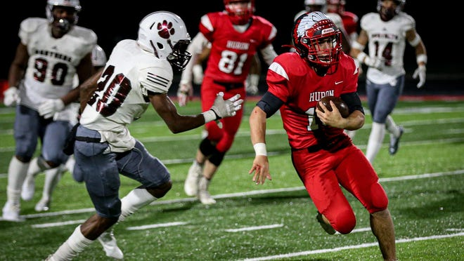 New Boston Huron's Tycen Stevens, makes a run in the fourth quarter quarter Friday against Jalen Heath of River Rouge.