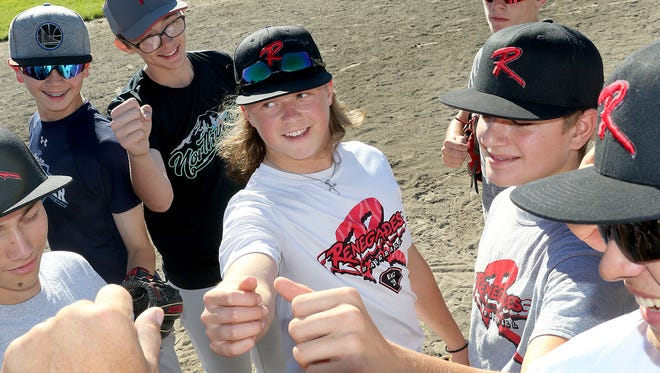 The DeMarini Renegades youth baseball team will play for a 16-and-under GSL Baseball state championship on Monday at Cheney Stadium. They have dedicated Monday's game, and the remainder of their season, to the memory of Sean O'Neil, father of Logan O'Neil, center. Sean O'Neil died last month of cancer.