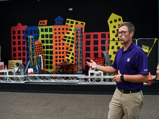 Pastor Lawson Clary looks at one of the children's classrooms, with a construction theme, at the new location of 5 Point Church on S.C.8 near U.S. 123 in Easley on Tuesday.