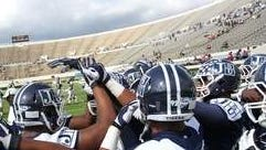 Jackson State players huddle before the intrasquad scrimmage that replaced the Tigers' scheduled homecoming game after Grambling players refused to travel. The school charged no admission and about 5,500 attended. A crowd in excess of 20,000 was expected for the regularly scheduled game.