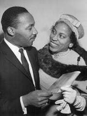 Dr. Martin Luther King Jr., noted integration leader, chats with Mrs. Clifford Bayles preceding his Nov. 12, 1959 talk in Des Moines. Mrs. Bayles is president of the Des Moines branch of the National Association for the Advancement of Colored People, which sponsored the talk at University Christian Church.