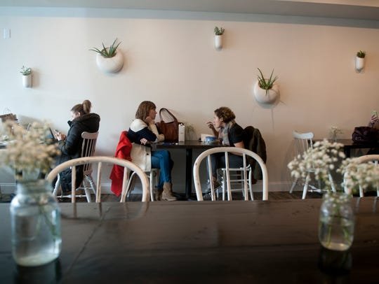 Customers eat lunch in the cozy, romantic interior