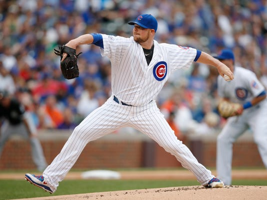 Chicago Cubs starting pitcher Jon Lester delivers against the Chicago White Sox during the first inning of a baseball game in Chicago, Saturday, July 11, 2015. (AP Photo/Andrew A. Nelles)